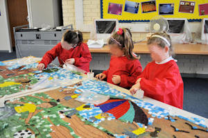 Children creating their mosaic